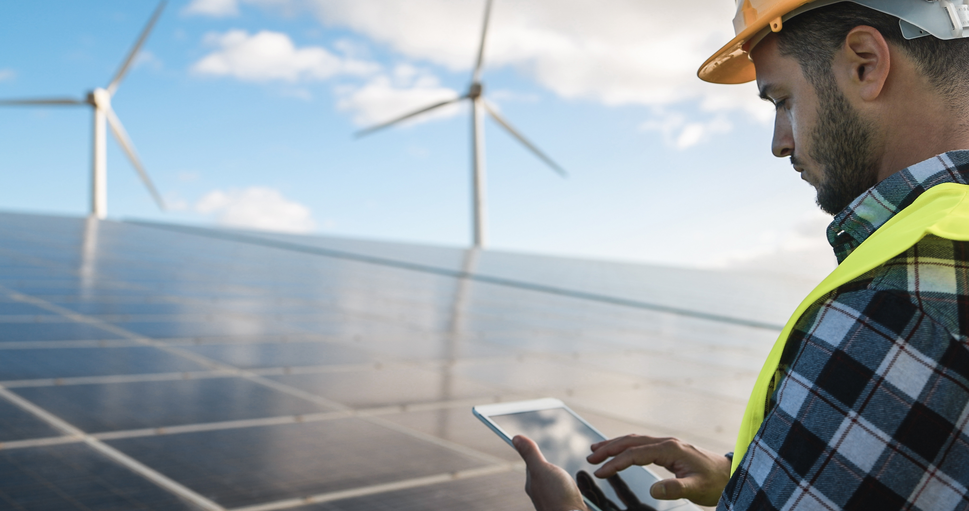young-man-working-with-digital-tablet-at-renewable-FY7899J